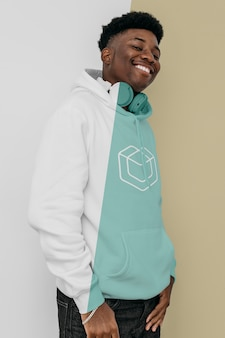 Stylish man in hoodie with headphones