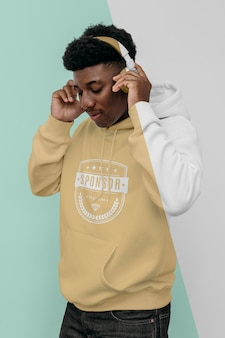 Stylish man in hoodie with headphones