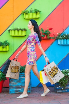 Stylish woman with shopping bags mockup
