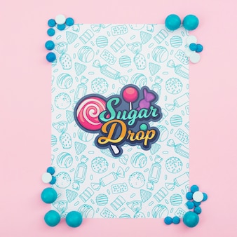Sugar drop poster mock-up with blue candies Free Psd