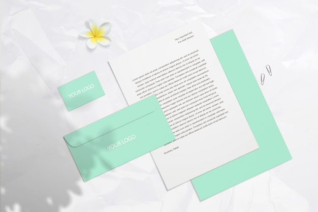 Summer blank branding mockup with mint business cards, envelopes  isolated on light surface with flower and shadows. psd smart layer can move