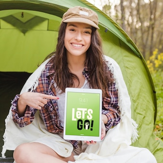 Summer camp mockup with woman pointing at tablet