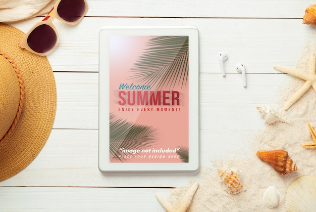 Summer composition with tablet mockup and beach accessories