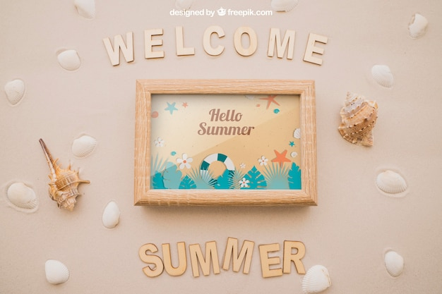 Summer concept with frame in sand