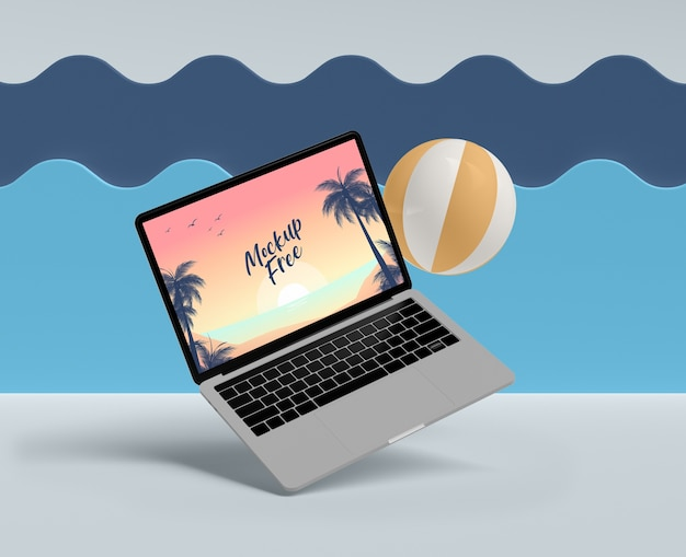 Summer concept with laptop and ball