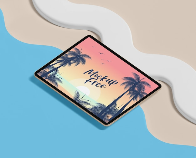 Summer concept with tablet and beach
