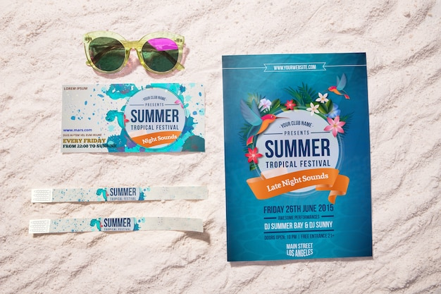 Summer event flyer and tickets on sand