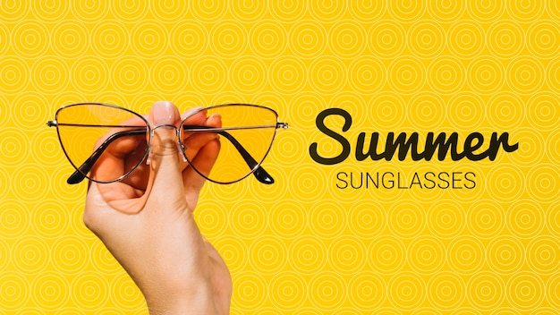 Summer fashion sunglasses held in hand