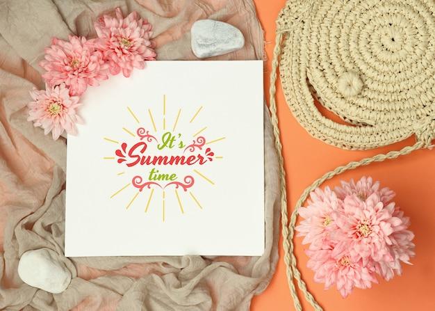 Summer flat lay mockup frame with bag and shawl