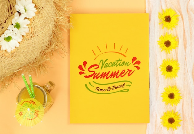 Summer mock yellow letter with straw hat and orange juice