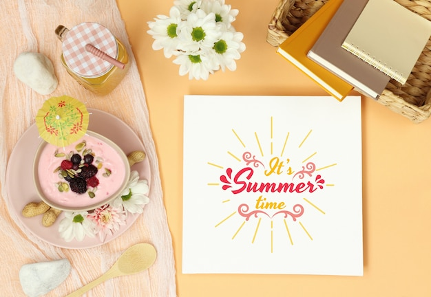 Summer mockup frame with straw hat and dessert