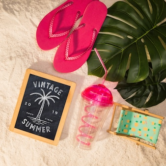 Summer mockup with colorful sandals and tropical leaves