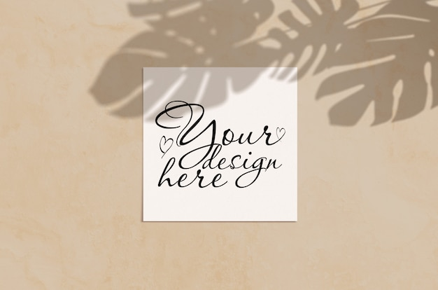 Summer modern sunlight stationery mockup scene. flat lay top view blank greeting card with monstera leaf shadow overlay