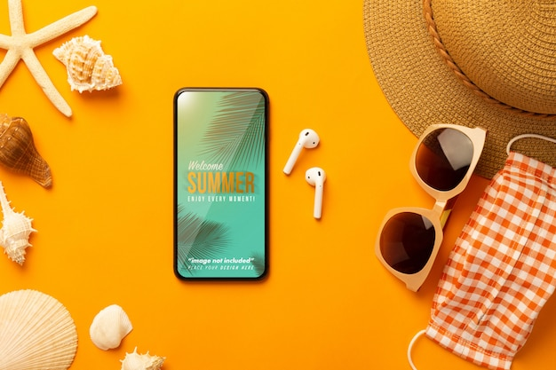 Summer scene with phone mockup and beach accessories, mask