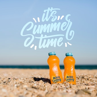 Summer time bottles in the sand mockup