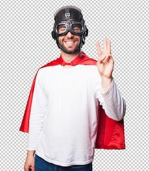 Super hero doing number three gesture
