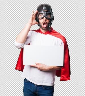 Супер герой держит белый плакат