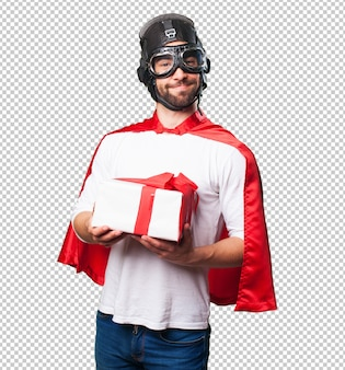 Super hero holding a gift