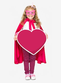 Superhero girl holding a heart icon