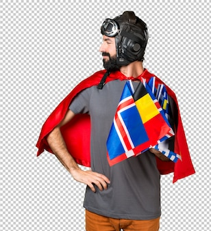 Superhero with a lot of flags looking lateral