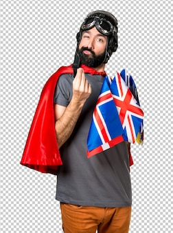 Superhero with a lot of flags making money gesture