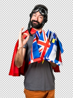Superhero with a lot of flags making ok sign