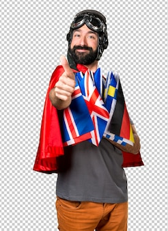 Superhero with a lot of flags with thumb up