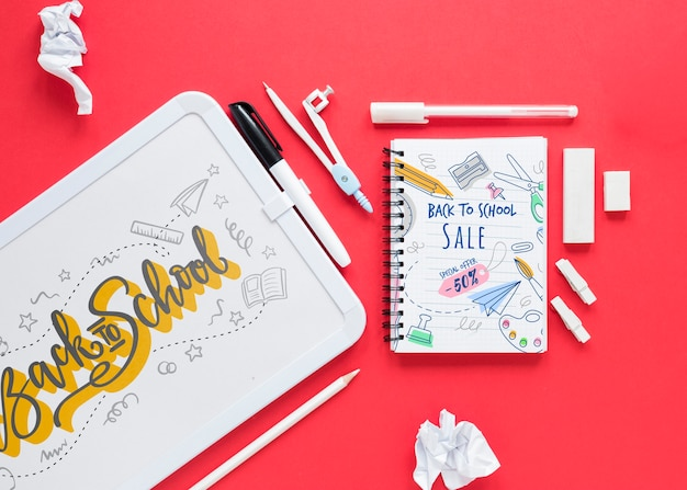 Supplies for school with white board on red background