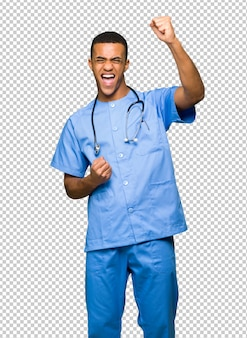 Surgeon doctor man celebrating a victory