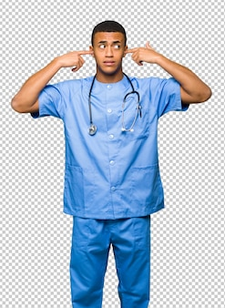 Surgeon doctor man covering both ears with hands
