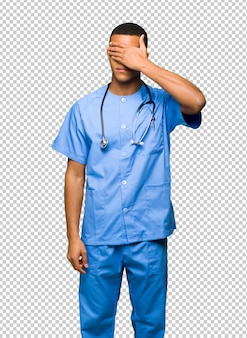 Surgeon doctor man covering eyes by hands. do not want to see something