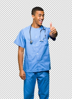 Surgeon doctor man giving a thumbs up gesture because something good has happened