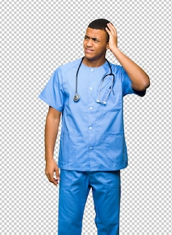 Surgeon doctor man having doubts while scratching head
