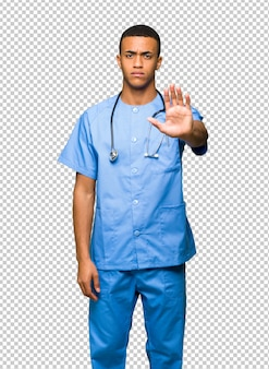 Surgeon doctor man making stop gesture denying a situation that thinks wrong