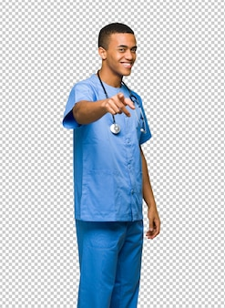 Surgeon doctor man points finger at you with a confident expression