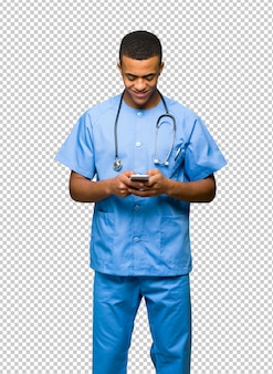 Surgeon doctor man sending a message with the mobile