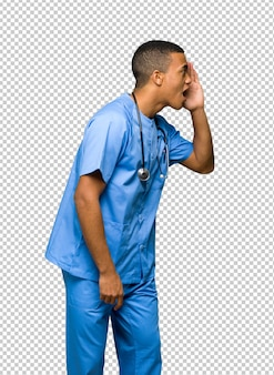 Surgeon doctor man shouting with mouth wide open to the lateral