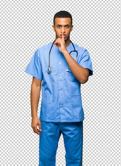 Surgeon doctor man showing a sign of silence gesture putting finger in mouth