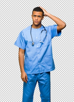 Surgeon doctor man with an expression of frustration and not understanding
