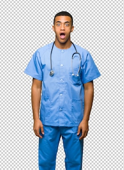 Surgeon doctor man with surprise and shocked facial expression