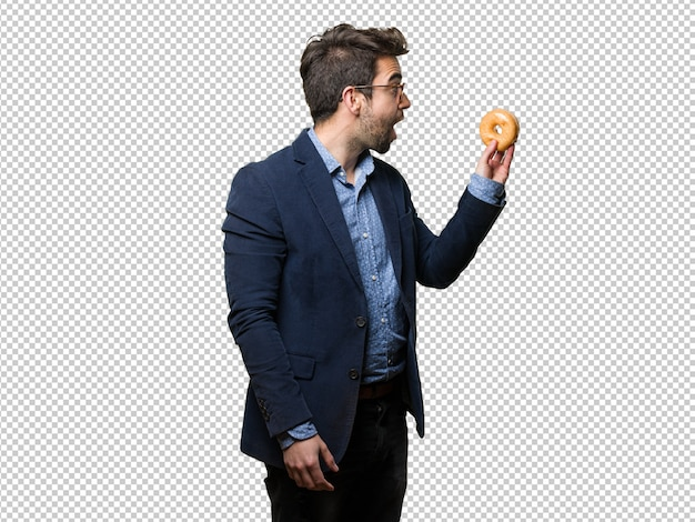 Surprised business man holding a doughnut