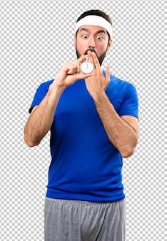 Surprised funny sportsman holding vintage chronometer