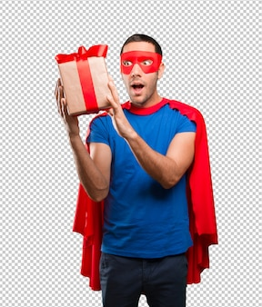 Surprised superhero with a gift