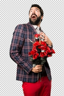 Surprised well dressed man holding flowers