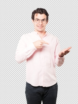Surprised young man holding something with his hand