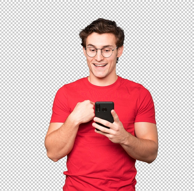 Surprised young man using his mobile phone