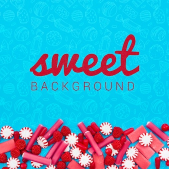Sweet background with pink candies and raspberries