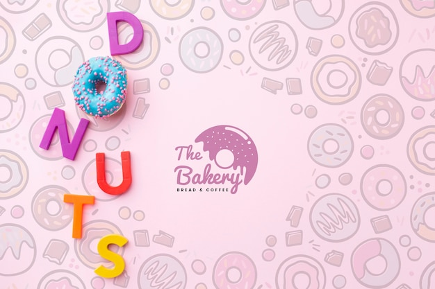 Sweet donut and letters arrangement with mock-up