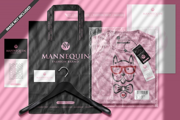 T-shirt in plastic bag with branding items scene mockup