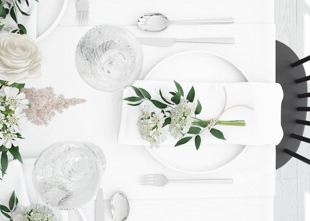 Стол, приготовленный для еды со столовыми приборами и декоративными цветами на вид сверху